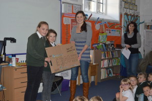 Ellie and Charlie presenting the cheque to Son